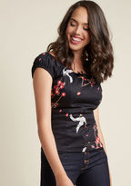 AW170401D You're pleased as can be over this off-the-shoulder top and you want the world to know it! This black cotton top from Collectif is graced with a tied neckline keyhole, a peaceful crane print, and pop-of-red cherry blossoms, bringing pin-up-inspired