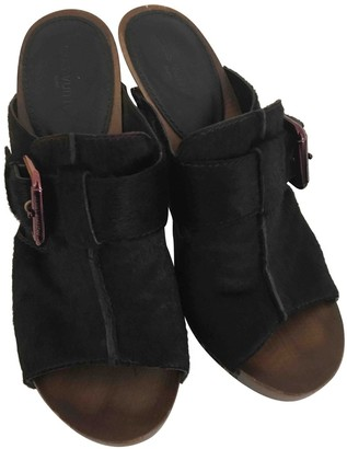Louis Vuitton Brown Pony-style calfskin Mules & Clogs
