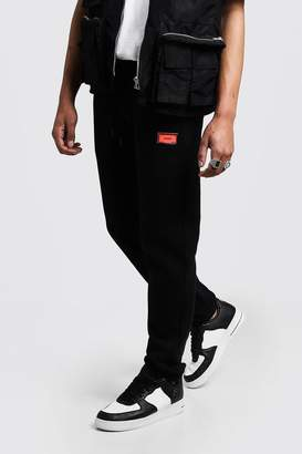 Skinny Fit Rubber MAN Badge Jogger With Toggle