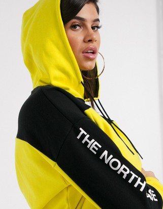 The North Face Flyweight hoodie in yellow