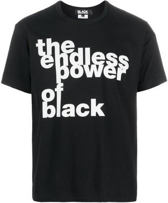 Black Comme Des Garçons slogan-print cotton T-shirt
