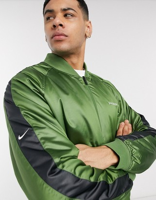 Nike Swoosh reversible bomber jacket in green/black
