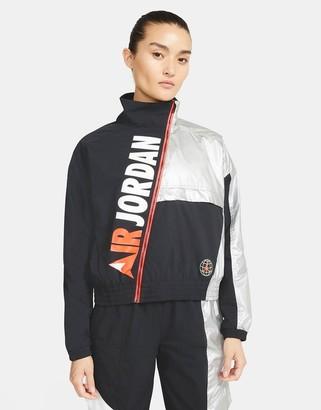 Jordan Nike Urban MTN logo jacket in black/reflective silver
