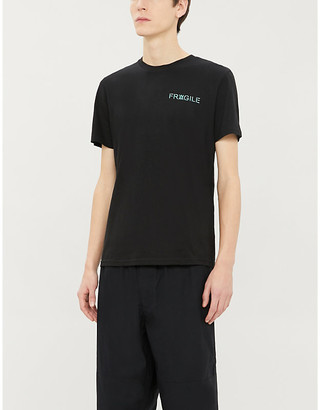 DANIEL ARSHAM Lock Up logo-print cotton-jersey T-shirt