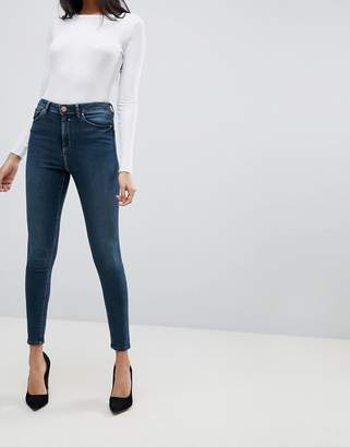 Asos DESIGN Ridley high waist skinny jeans in aged blue wash