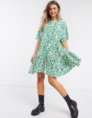 ASOS DESIGN plisse mini smock dress in green daisy floral print