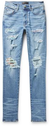 Amiri Skinny-Fit Distressed Panelled Stretch-Denim Jeans
