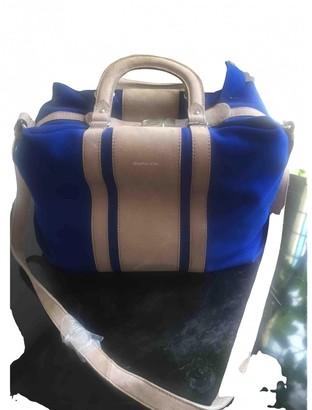 Carven Blue Suede Handbags