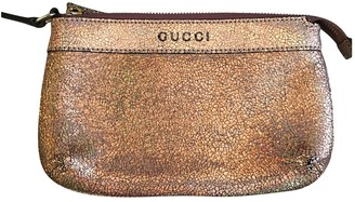 Gucci Metallic Leather Clutch bags