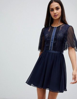 ASOS DESIGN mini dobby skater dress with embellished trim