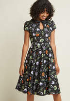 What's not to adore about this black midi dress from Hell Bunny? Festive from its dotted Peter Pan collar and keyhole-touched neckline and sleeves down to its hidden pockets and spirited print of witchy kitties, pumpkins, and a mysterious night sky, this