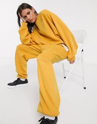 Nike mini swoosh oversized yellow joggers