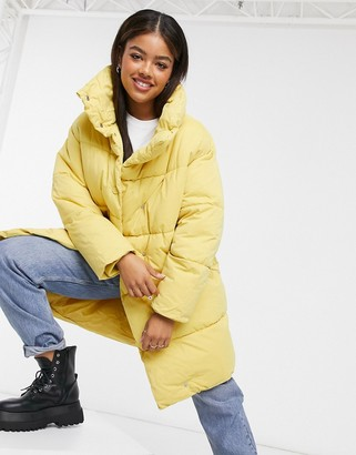 Monki Vickan padded coat in yellow