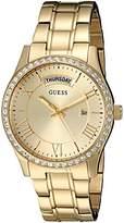 GUESS Women's U0764L2 Dressy Gold-Tone Stainless Steel Multi-Function Watch with Day & Date Dial and Pilot Buckle