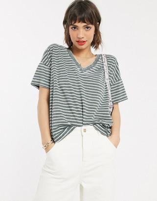 Asos DESIGN oversized v neck t-shirt with in burnout stripe