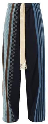 Loewe Anagram Jacquard-striped Cotton Trousers - Mens - Navy Multi