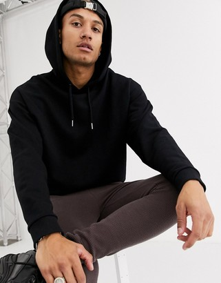 ASOS DESIGN oversized hoodie with curved hem in black