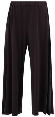 Issey Miyake Wide-leg Hem-slit Jersey Trousers - Womens - Dark Grey
