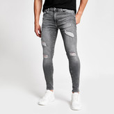 River Island Grey Ollie spray on skinny ripped jeans