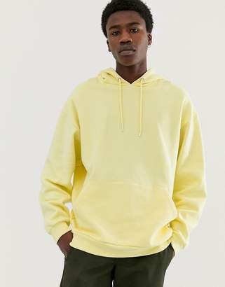 Asos Design DESIGN oversized hoodie in pale yellow