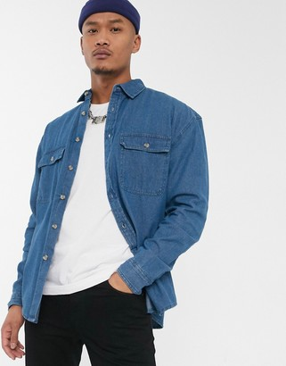 Asos DESIGN oversized organic denim shirt with double pockets in mid wash