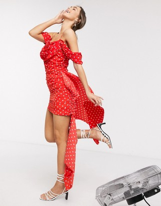 In The Style x Jac Jossa exclusive drape off shoulder ruched mini dress with train detail in red polka print