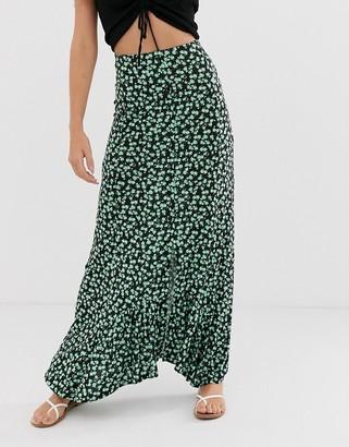 Asos Design DESIGN dip hem maxi skirt with button front in urban floral-Green