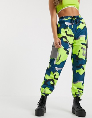 Nicce relaxed cargo pants with reflective pockets in bright camo co-ord