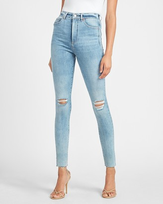 Express Super High Waisted Hyper Stretch Ripped Raw Hem Skinny Jeans