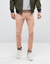 Asos Super Skinny Jeans With Camo Turn Up In Pink