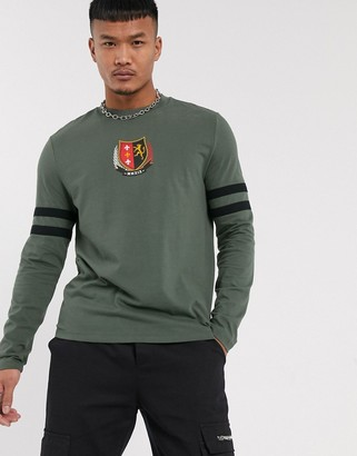 Asos DESIGN organic cotton long sleeve t-shirt with emblem chest print and sleeve color block