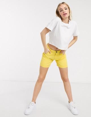 Noisy May long denim shorts with raw hem in yellow