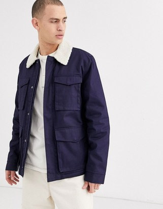 Asos DESIGN jacket with wax finish and fleece collar in blue