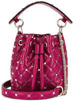 Valentino Mini Rockstud Spike Bucket Bag in Raspberry Pink | FWRD