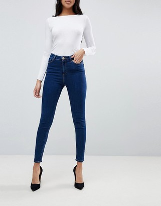 Asos DESIGN Ridley high waisted skinny jeans in deep blue wash