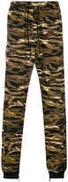 Puma camouflage print track pants