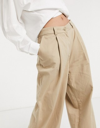 Weekday Tenley organic cotton wide leg pleat front trousers in beige