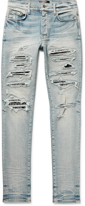 Amiri Thrasher Skinny-Fit Distressed Panelled Stretch-Denim Jeans