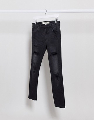 New Look jeans with rips in black