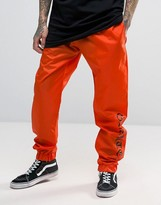 Granted Cuffed Joggers In Orange With Text