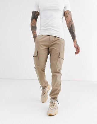 ASOS DESIGN slim cargo trousers with toggle hem in stone ripstop