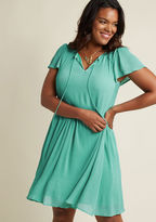 D-61494 One wear of this completely pleated dress is never enough! In no time, you'll return to its fluttery cap sleeves, tied neckline, and gathered waist with new ideas of how to style its head-turning turquoise hue. A ModCloth exclusive, this retro A-line is a