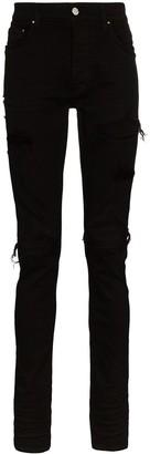 Amiri MX1 suede patch skinny jeans