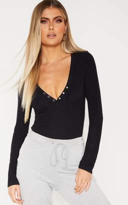 PrettyLittleThing Tall Black Long Sleeve Popper Detail Thong Bodysuit