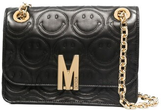 Moschino M quilted clutch bag