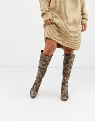 Topshop heeled knee high boots in snake print