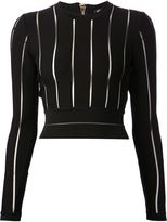 kim kardashian  Who made Kim Kardashians red long sleeve stripe dress and studded lace up pumps?