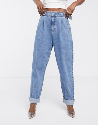 ASOS DESIGN Tapered boyfriend jeans with D-ring waist detail with curved seams in mid blue