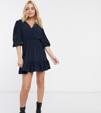 ASOS DESIGN Petite wrap front ruffle hem mini dress with puff sleeve in navy