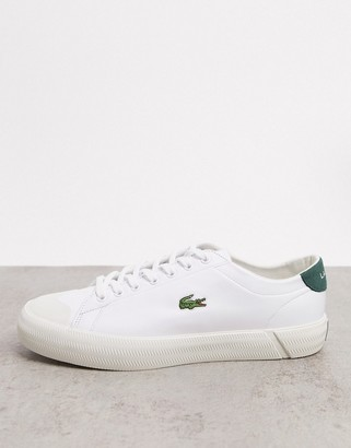 Lacoste gripshot sneakers in white green leather